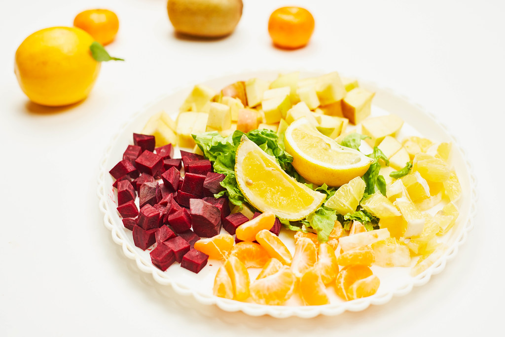 Plate of sliced fruits and vegetables for weight losing