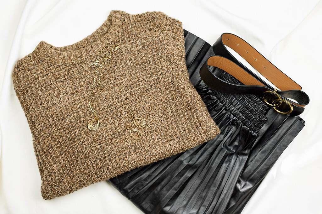 Trendy leather skirt and knitted warm sweater
