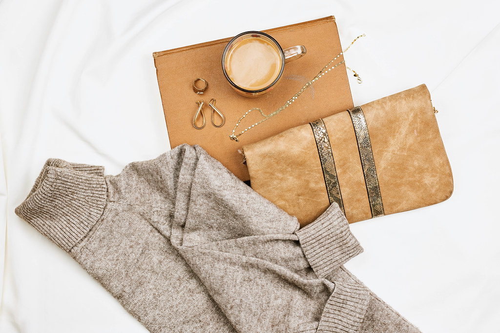 Women's clutch, sweater and jewelry