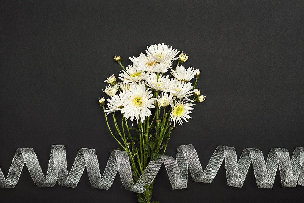 A bouquet of beautiful white flowers with ribbon