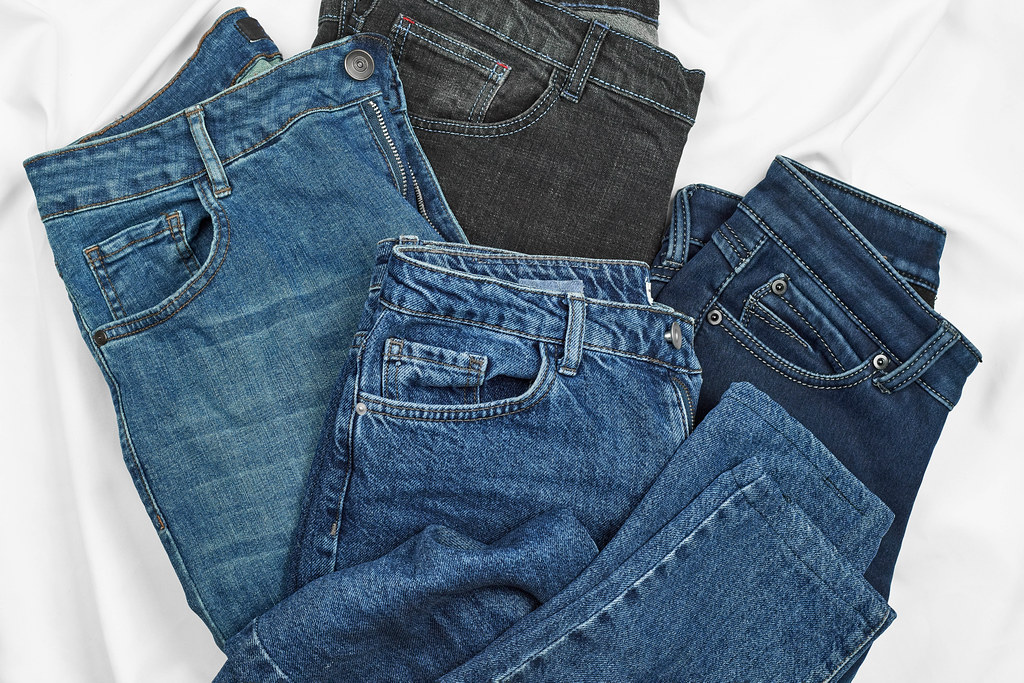 Close-up view of four stylish jeans