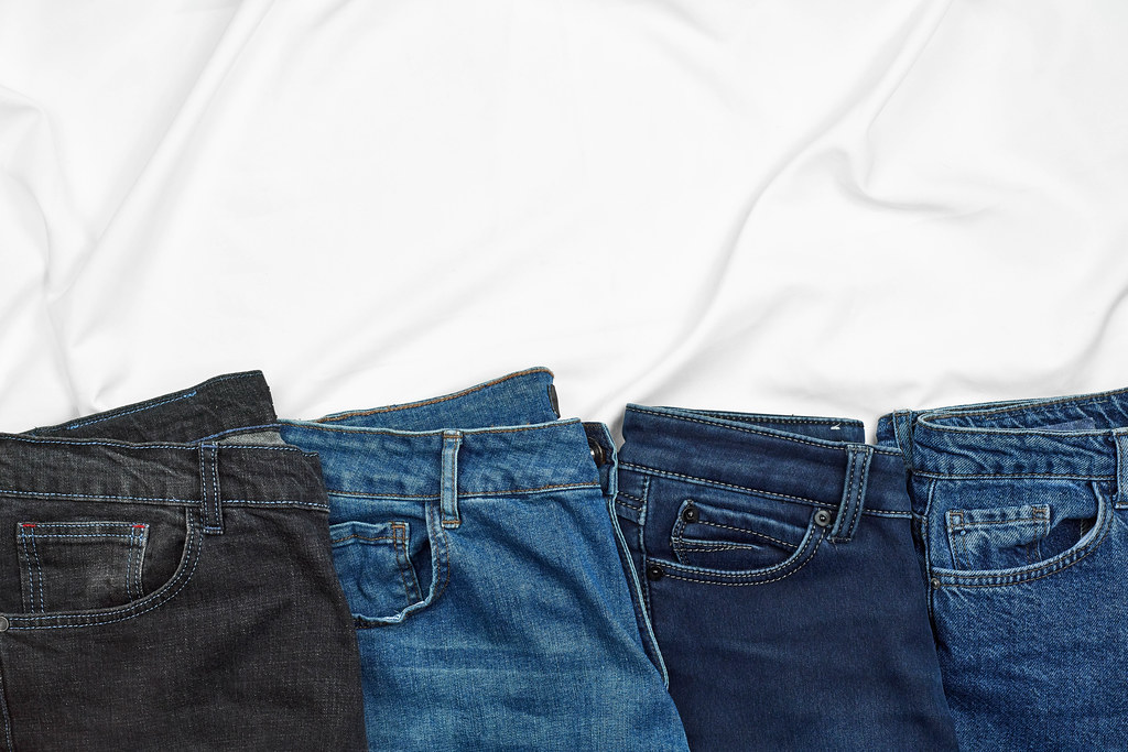 Row of casual jeans pants with copy space