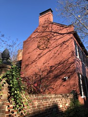Red brick house with clock face fragment, P Street NW, Georgetown, Washington, D.C.