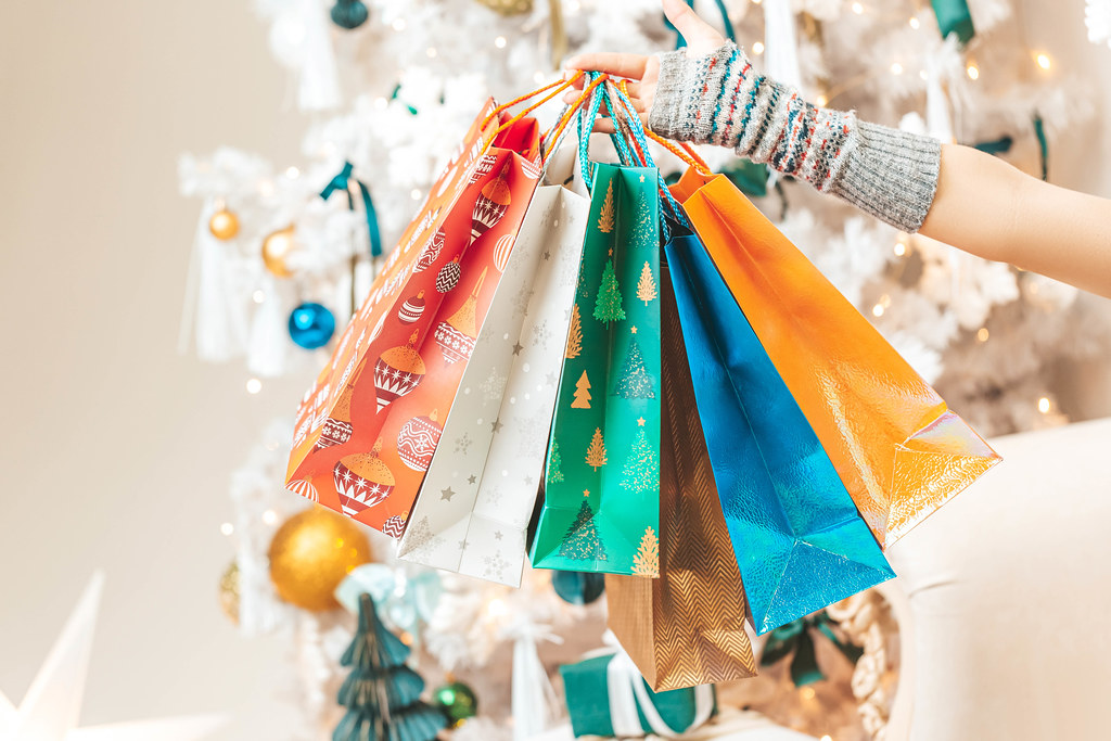 Multicolored gift bags in hand