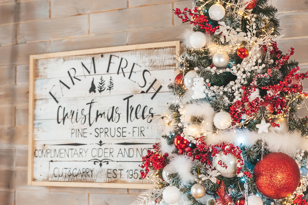 Beautiful decorated christmas tree with wooden signboard on the wall