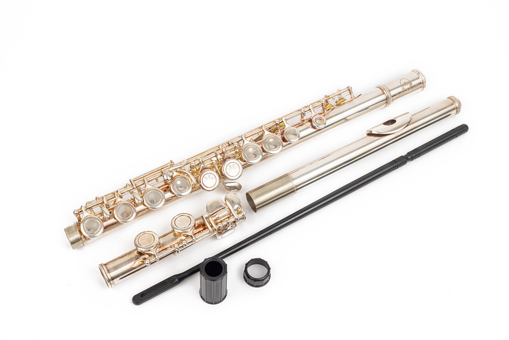 Metal Flute parts above white background