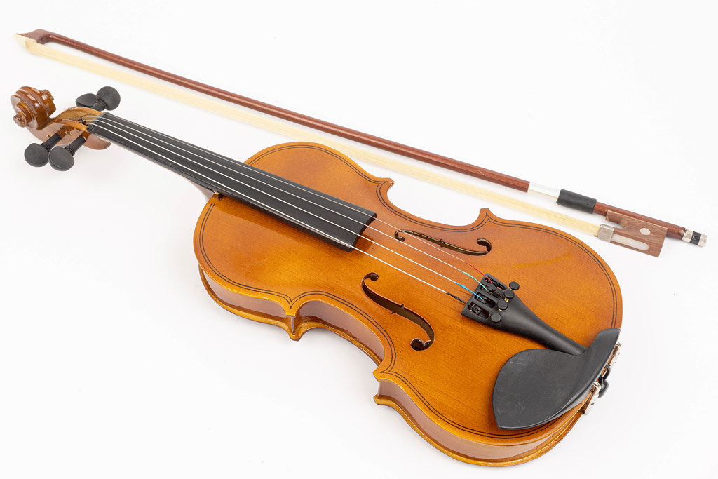 Wooden Violin with Fiddle Bow isolated above white background