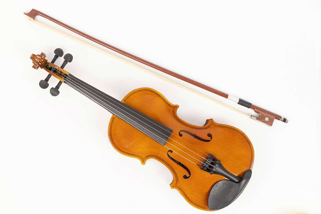 Top view of wooden Violin with Fiddle Bow