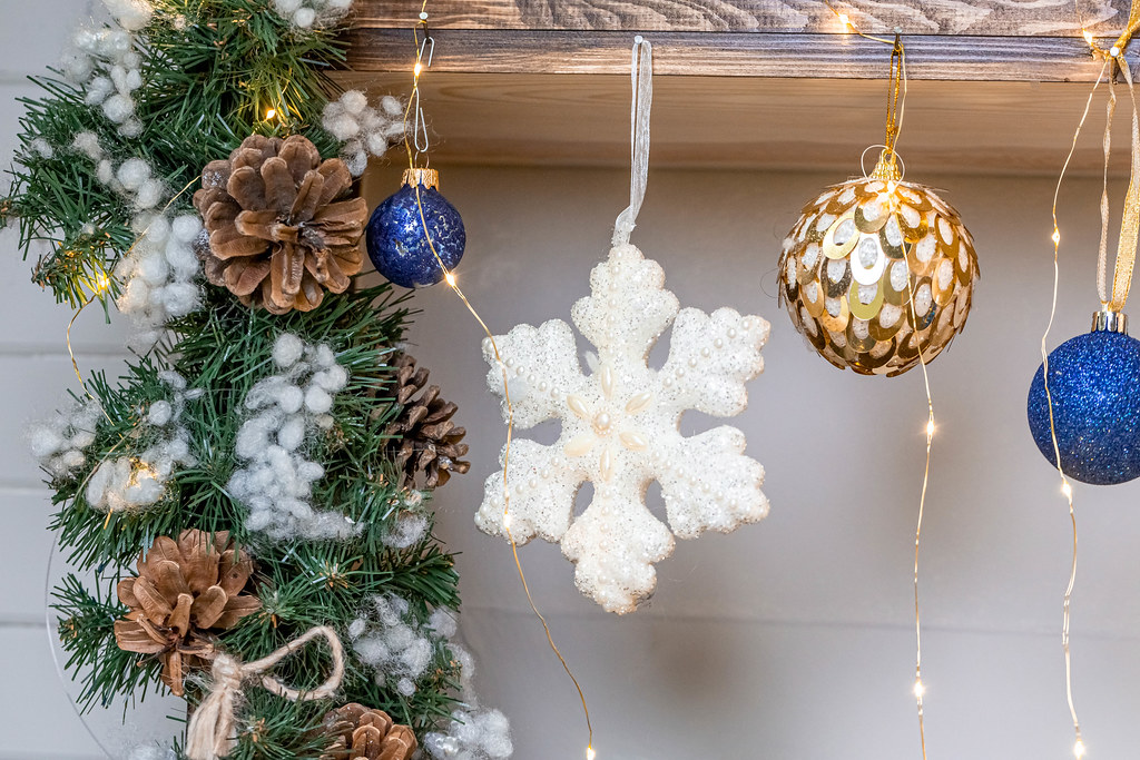 Christmas decor-snowflake, balls, tree branches, cones and garlands