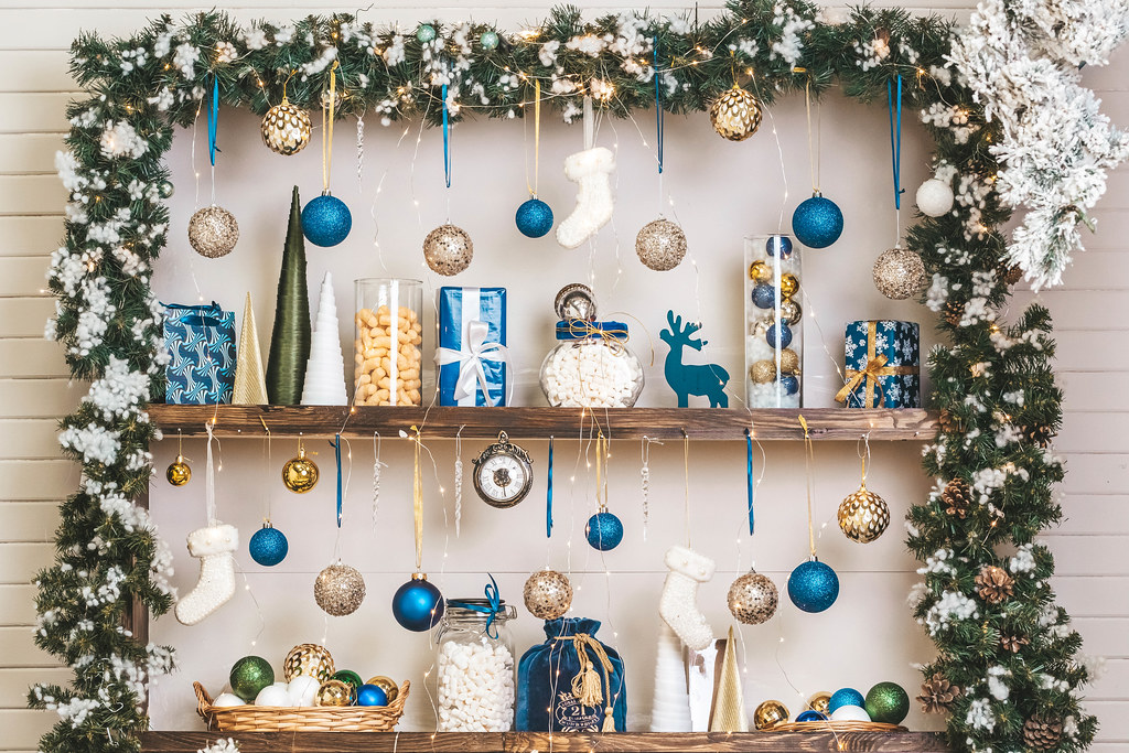 Beautifully decorated shelves with christmas attributes