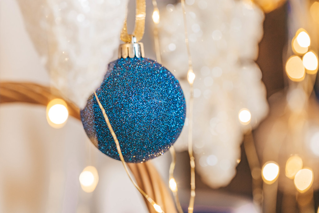 Close-up, blue ball on blurred christmas background