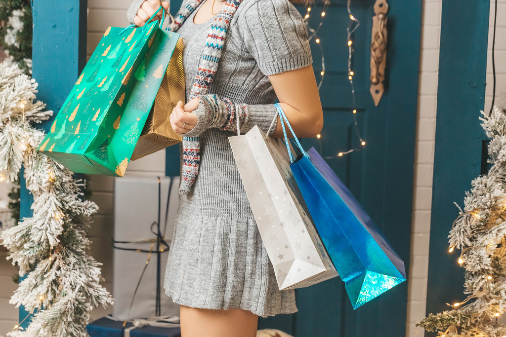 New Year's shopping concept, girl with packages in hands