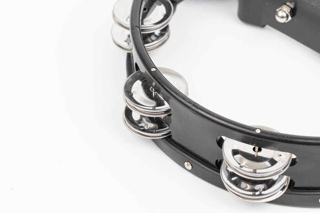 Black wood Tambourine isolated above white background with copy space