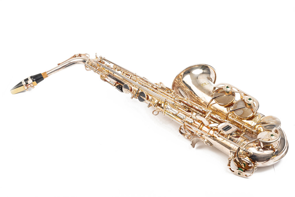 Golden Metal Saxophone isolated above white background