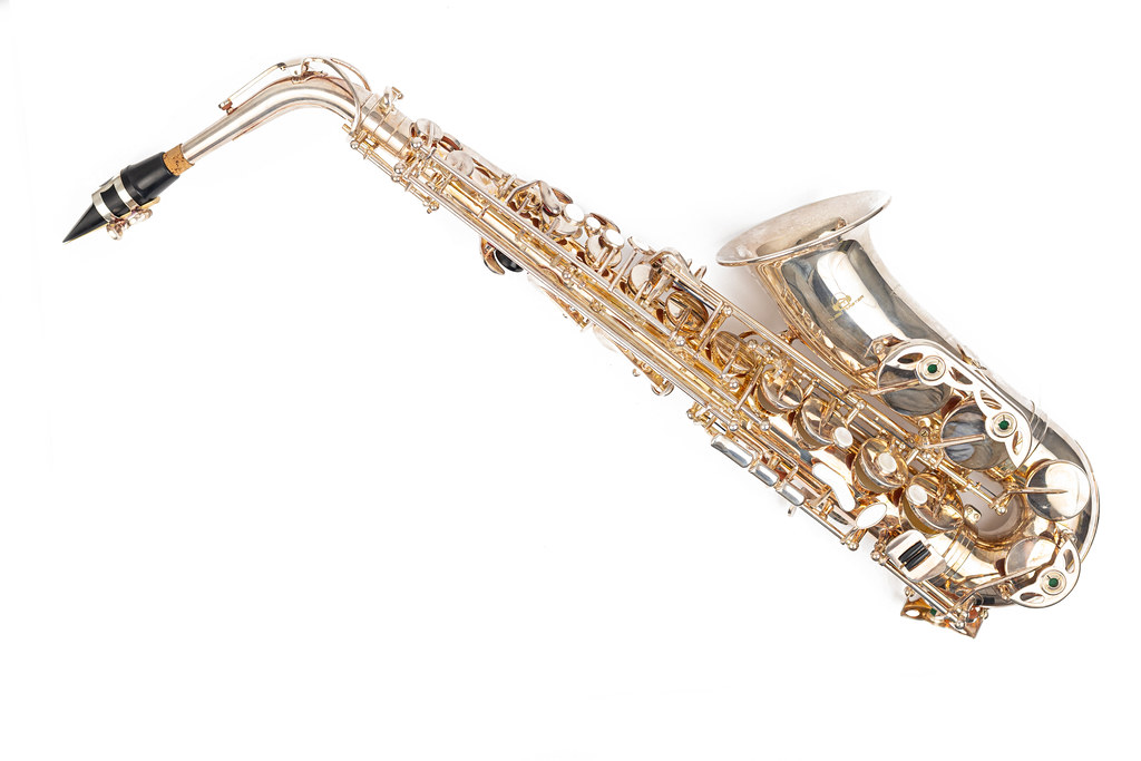 Golden Metal Saxophone above white background with copy space