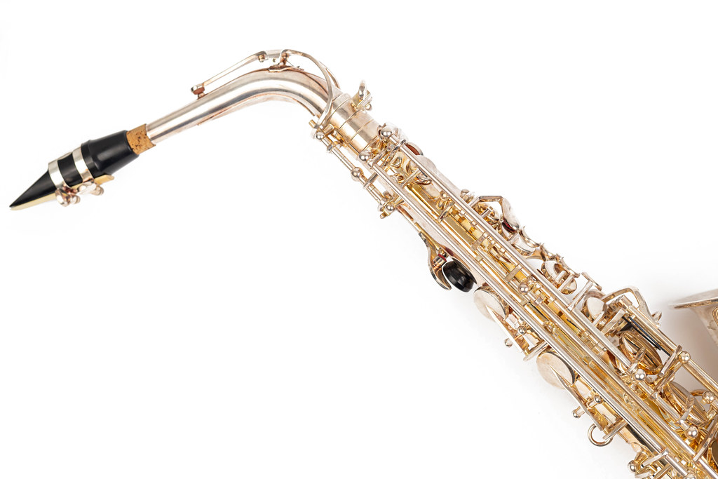 Golden Metal Saxophone with copy space above white