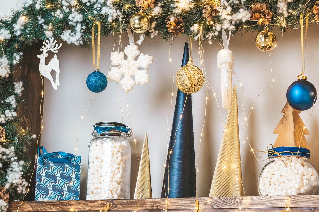 Christmas decor on shelves with garlands