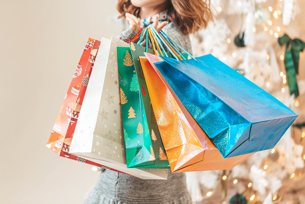 Happy new year, shopping and gifts concept for family and friends
