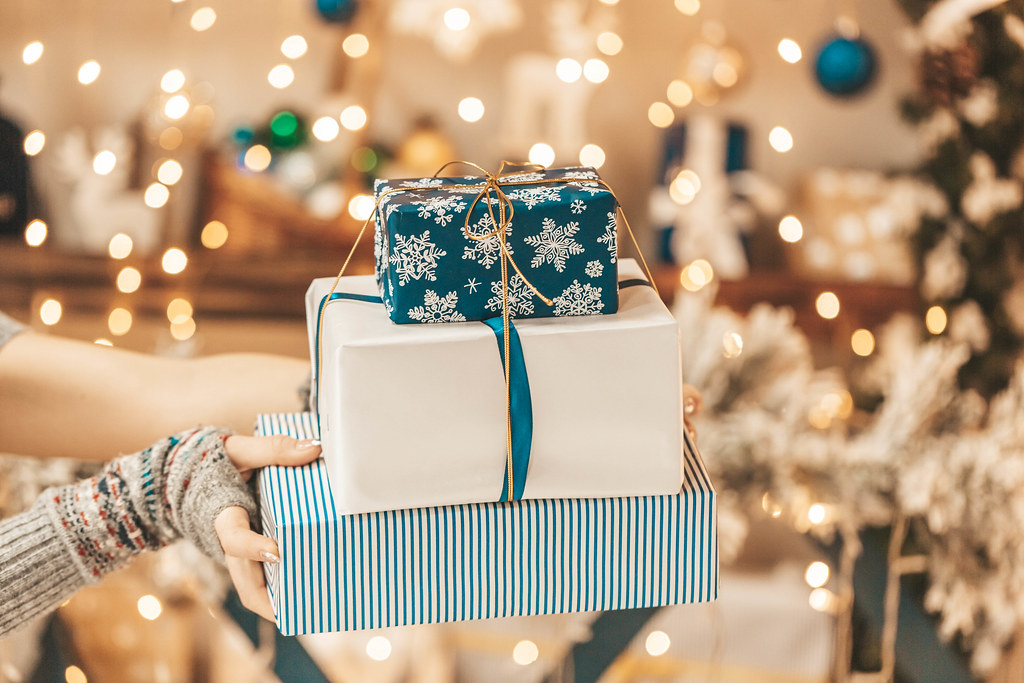 Stack of gifts on golden bokeh, merry christmas