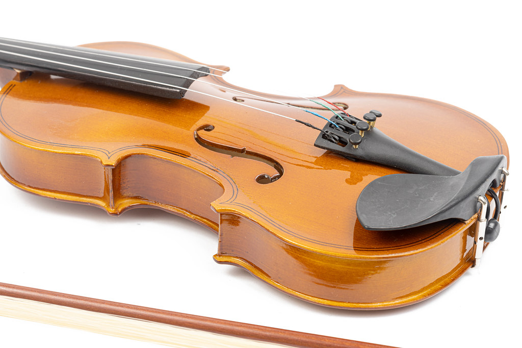 Violin with Fiddle Bow isolated above white background