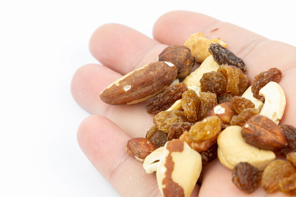 Energy Mix with Nuts and Raisins in the hand