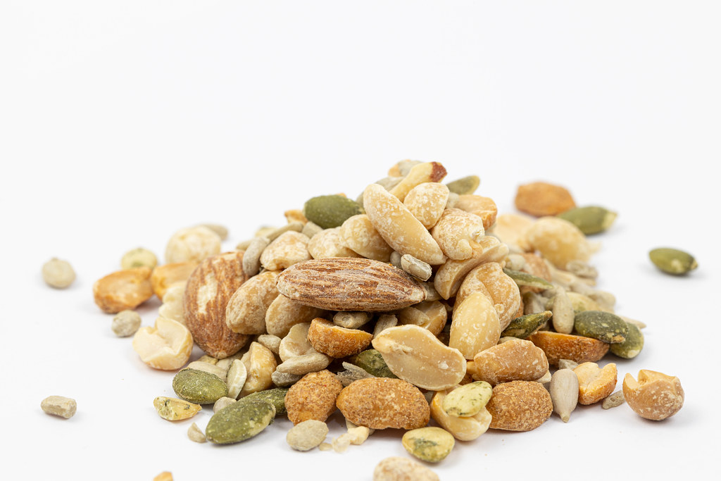 Energy Mix with Nuts and Raisins isolated above white background