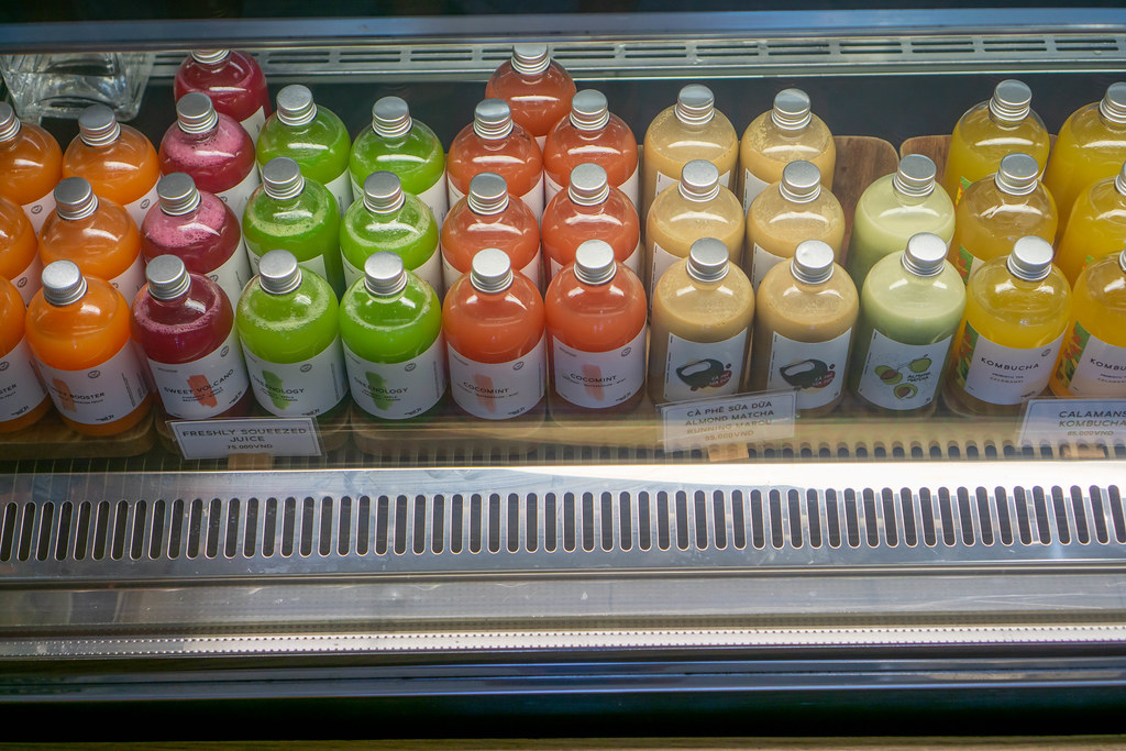 Freshly Squeezed Fruit Juices, Milk Coffee, Milk Tea and Kombucha in Glass Bottles in a Display Fridge