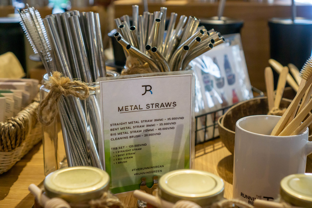 Different kinds of Metal Straws, Cleaning Brushes, Bamboo Toothbrushes and other Items for Sale in a Cafe