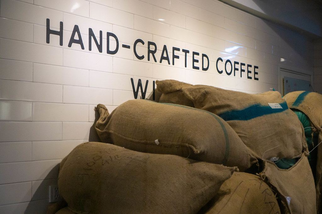 Large Burlap Coffee Bags with Freshly Roasted Coffee Beans in a Cafe and Restaurant in Ho Chi Minh City, Vietnam