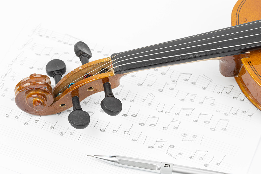 Wooden Violin with Notes on the sheet music