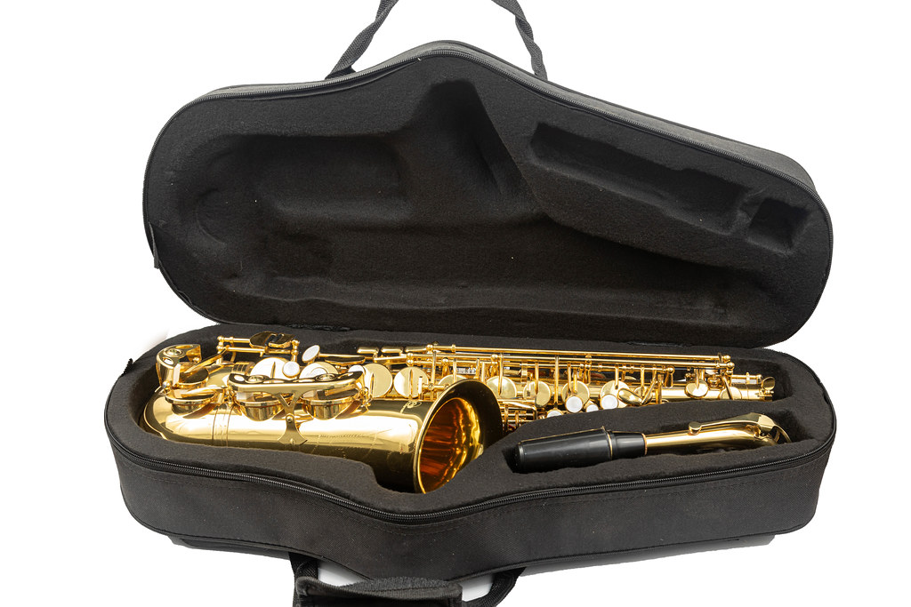 Packed Saxophone in the Case above white background