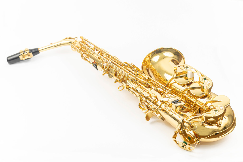 Golden color Saxophone isolated above white background