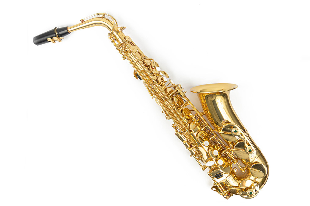 Saxophone above white background with copy space