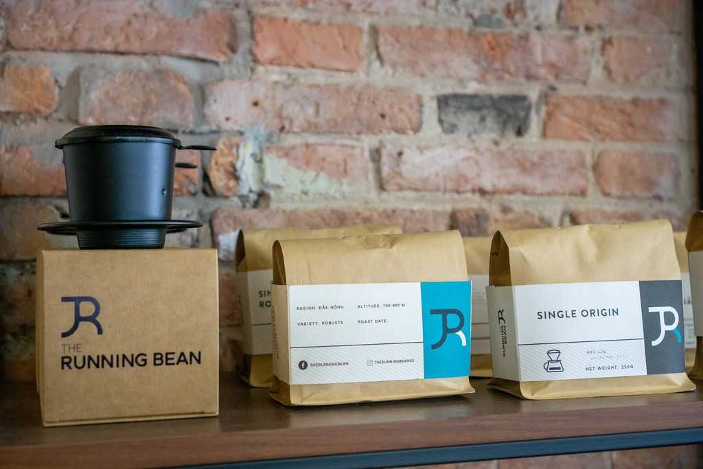 Grinded Robusta Coffee, Coffee Beans and Vietnamese Coffee Filter for Sale at The Running Bean Cafe in Ho Chi Minh City, Vietnam