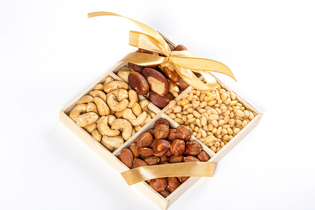 Healthy snack concept, set of nuts in a box with ribbon and bow