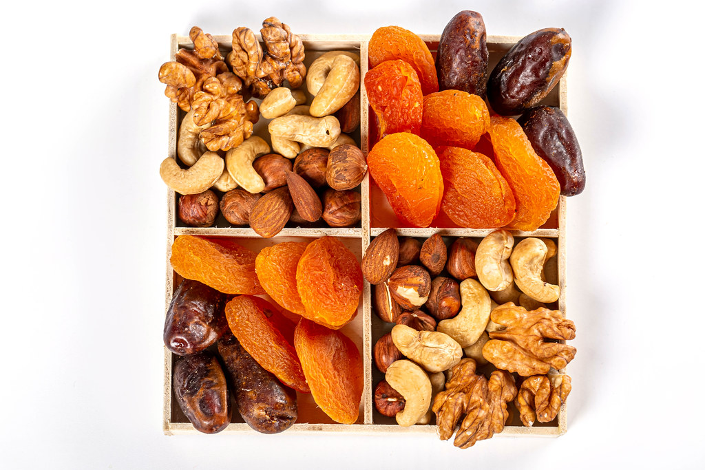 Top view, dried apricots, dates with various nuts in a box