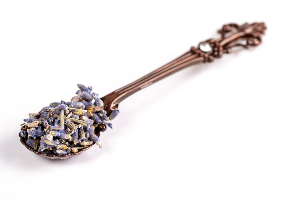Teaspoon with dried lavender flowers