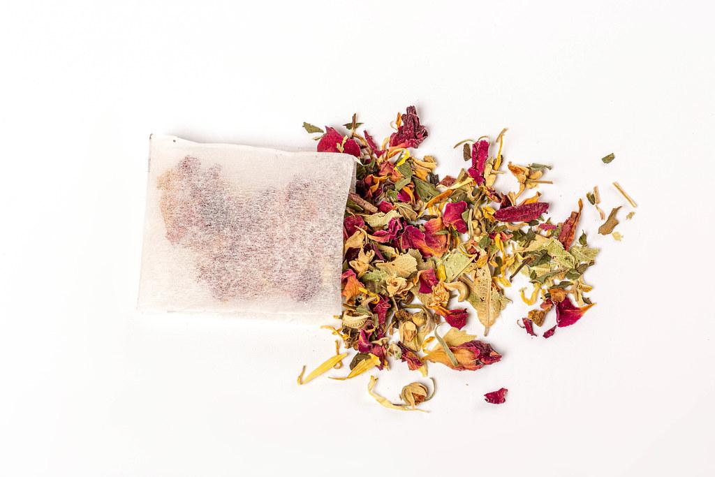 Floral green tea with tea bag, top view