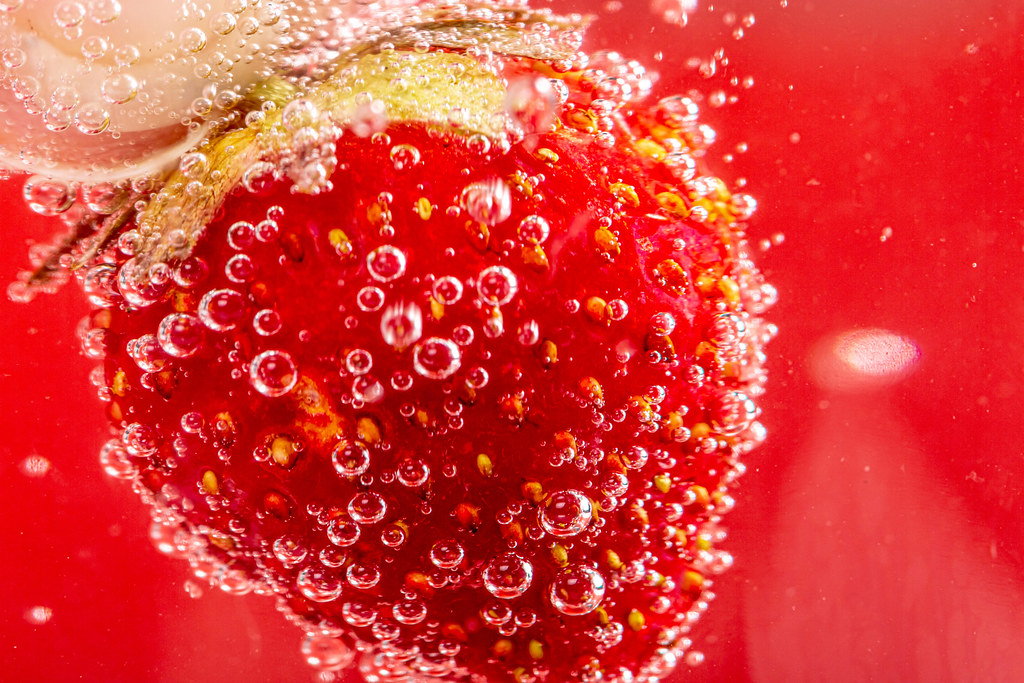 Close-up of ripe strawberries in sparkling water