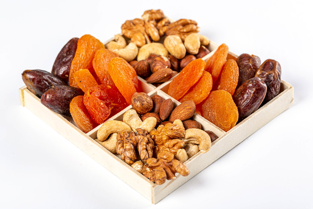 Nuts and dried fruits in a box, healthy snack concept