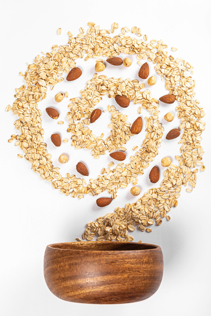 Diet food concept, oat flakes with almond and hazelnuts