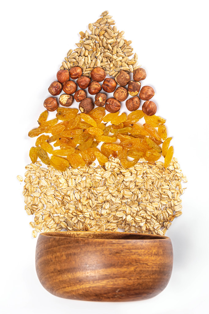 Sunflower seeds, hazelnuts, raisins and oatmeal - healthy food concept