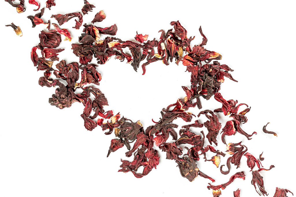 Heart made from dry red flower petals, the concept of love for tea