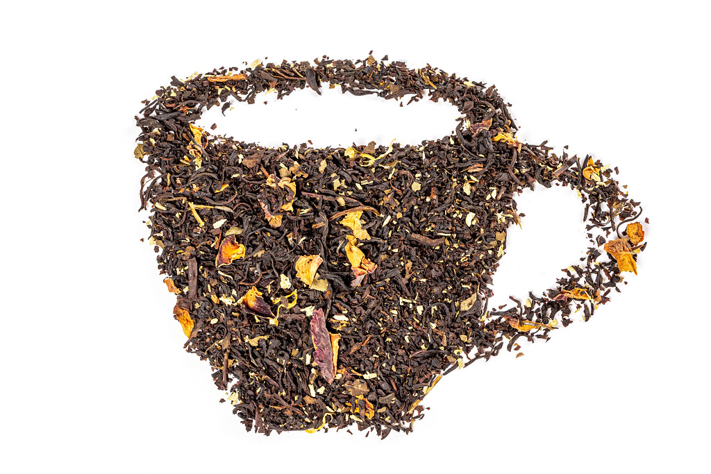 A cup of tea made from dried black tea leaves