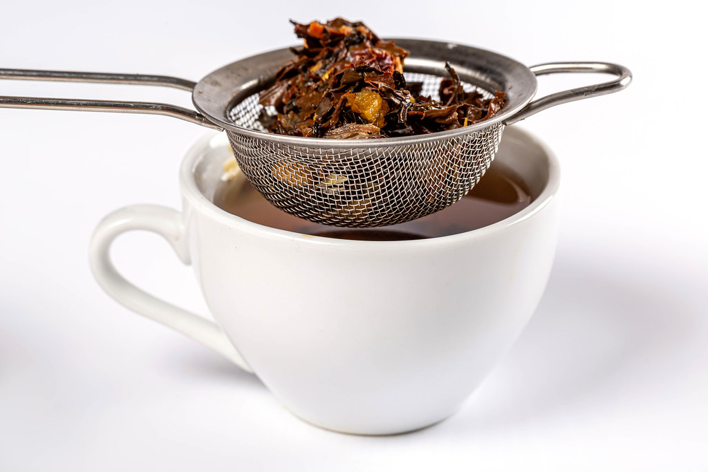 Cup of tea with metal sieve