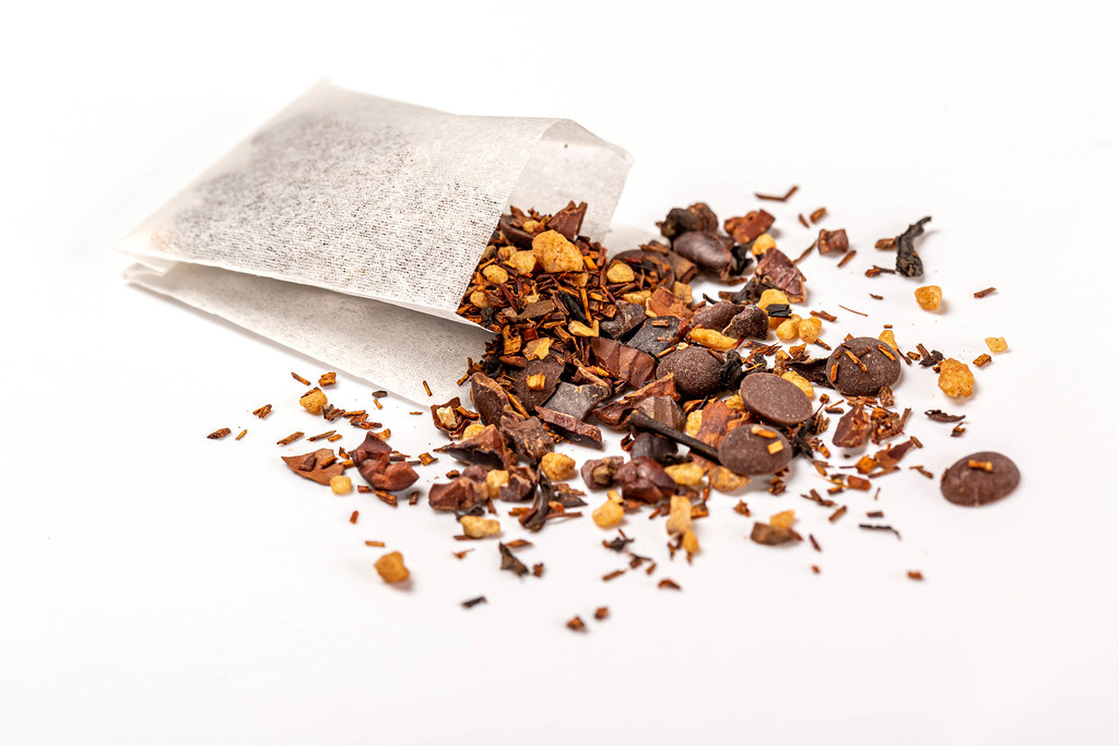 Close-up, tea with chocolate and pieces of nuts