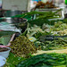 Vegetables and herbs  for sale from an outdoor street vendor.
