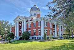 The Pasco County Courthouse, 37918 Meridian Avenue, Dade City, Florida, USA / Built: 1909 / Architect: Edward Columbus Hosford / Floors: 2 / Architectural Style: Classical Revival / Building Exterior: Brick / Added to NRHP: September 20, 2006