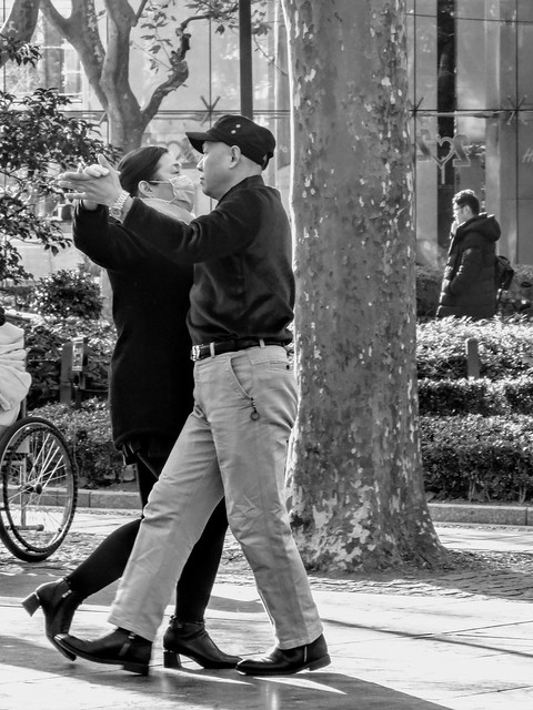 Masked ballroom dance in a city park