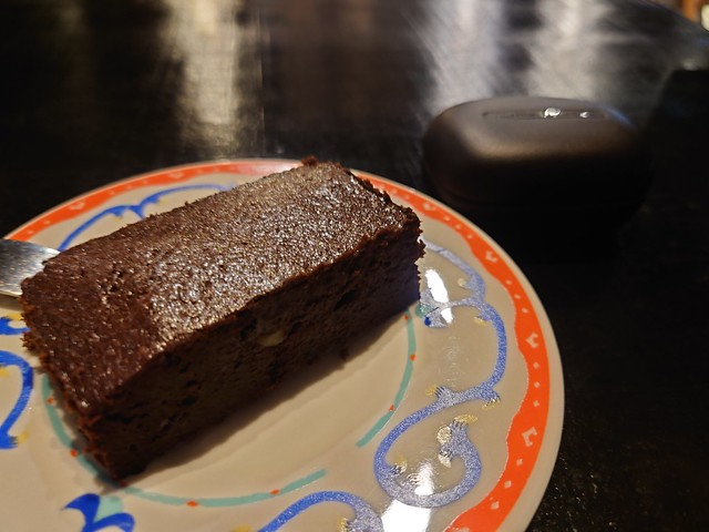 Two blocks, My chocolate cake and my Harman Kadon TWS earphone,